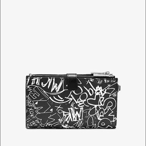bfbbf9bc0824 MK Adele Graffiti Leather Smartphone wallet. M_5c0e7c94df0307a570f80216.  Other Bags you may like. MICHAEL KORS WALLET